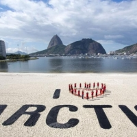 Greenpeace volunteers form an 'I Love Arctic' human banner at Botafogo beach, Rio de Janeiro.