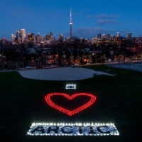 Greenpeace volunteers create a I Love Arctic human banner in Toronto.