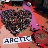 Over 300 Greenpeace volunteers create a I Love Arctic human banner at the Red Square in Nørrebros, Copenhagen.