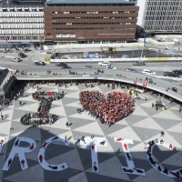 Greenpeace volunteers form an 'I Love Arctic' human banner in central Stockholm